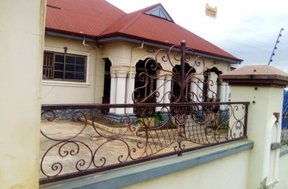 A 5 bedroom house with an uncompleted storey boys' quarters  for sale